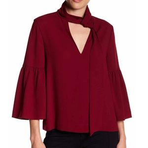 BCBC BELL SLEEVE TIE NECK TOP IN MAROON SZ XS